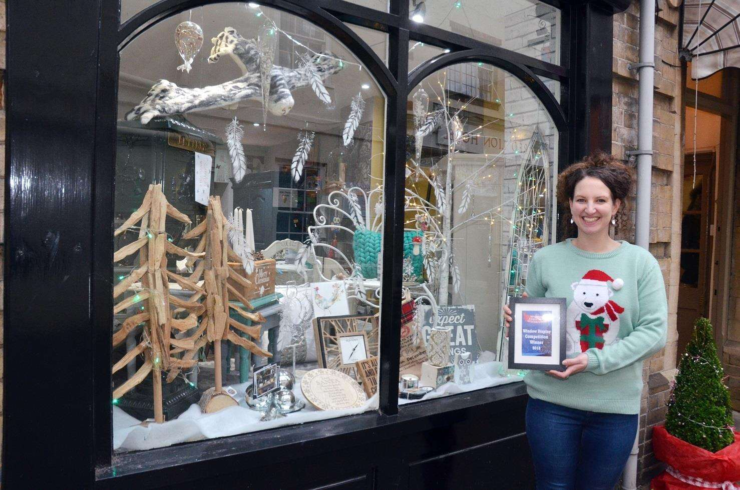 Pearl and Ruby shop window winner, Kayleigh Ayre inside and outside her winning window (6018668)