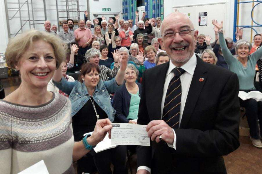 South Holland Singers chair Tess Murison is pictured receiving a cheque for �750 from David Shepherd,of the Masons, who is also the Singers' rehearsal accompanist and organist.