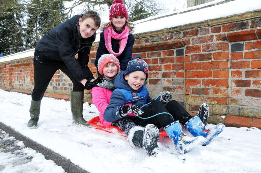 Schools out! Sledging in Gedney Churchend are (back) Kieran Briggs, Mia Huggett, (front) Jasmine and Jayden Huggett