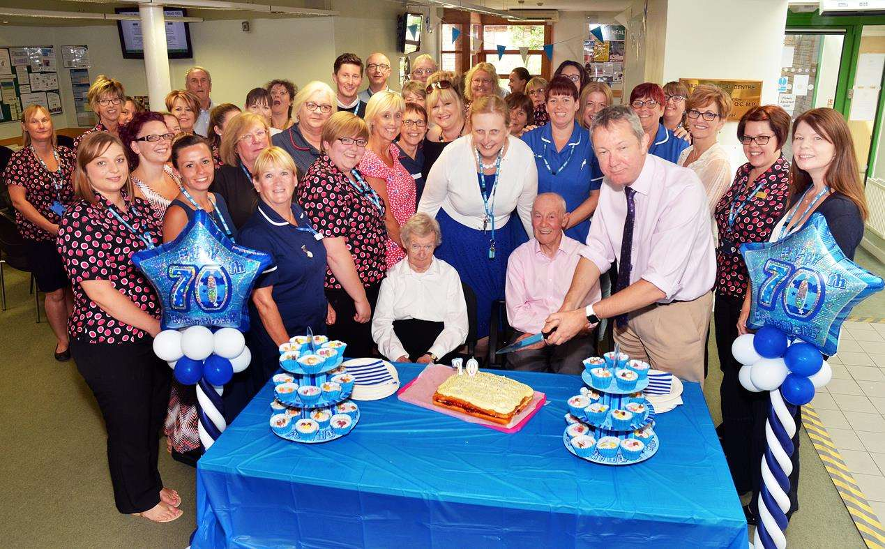 Dr Graham Wheatley (front right), senior practice partner at Munro Medical Centre, with nursing partner Teresa Hare, staff and patients Bernadette and Frank Blades, at a buffet to mark the 70th anniversary of the NHS.Photo by Tim Wilson.040718101SG