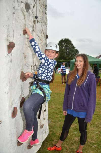Ashleigh Rogers climbs with the help of Amelia Davies in Cowbit