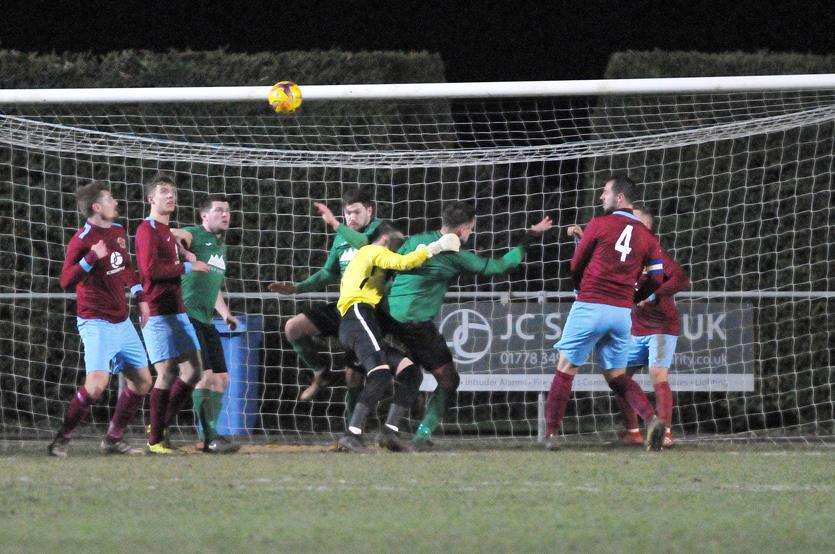 Lewis Elsom and Deeping's defence under pressure against Sleaford on Tuesday night.