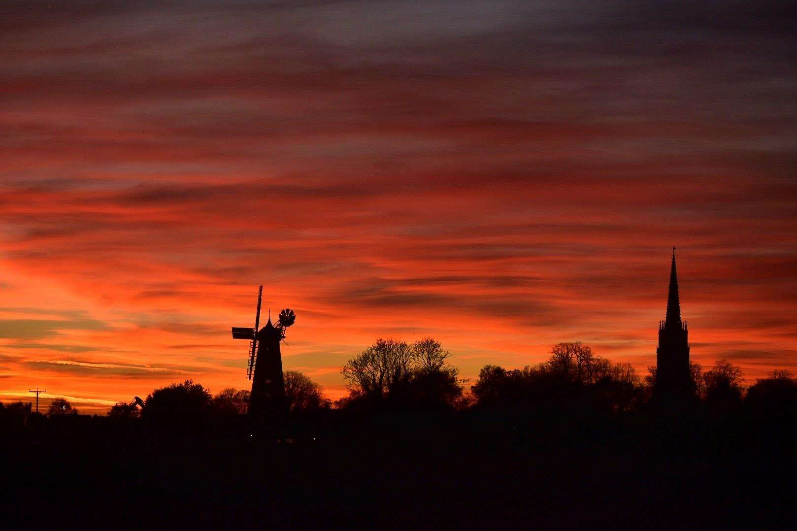 Ian Millward of Bourne took this lovely picture of Moulton Mill and the village church. (5523101)