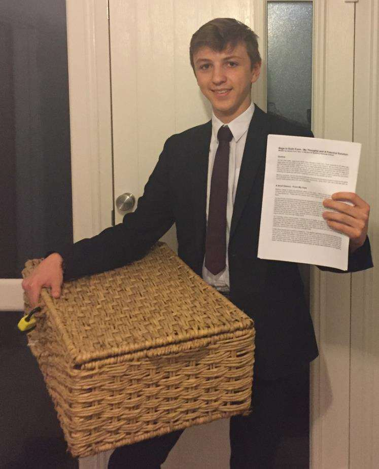 Jacob Ford with his 3,300-word 'document of defence' and a wicker basket which he used to carry his books, folders and equipment as part of a 'silent protest against the school's ban on large bags.Photo supplied.