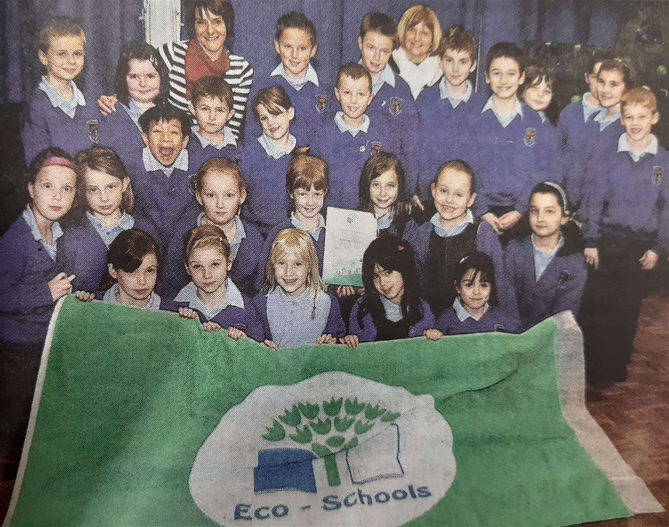Pupils at Spalding's Monkshouse Primary School show off their Green Flag Eco-Schools award in 2011.(43927592)