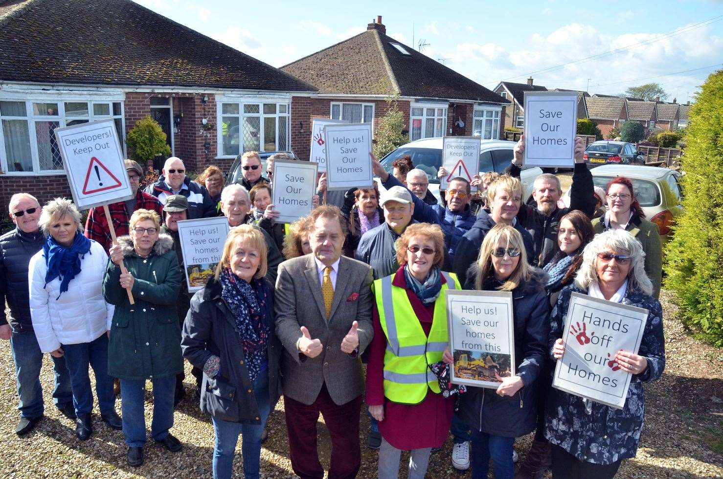 MP Sir John Hayes and Coun Angela Newton with residents outside homes threatened by bulldozers. (090319-3)
