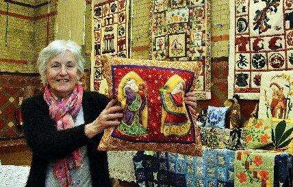 Trustee Rona Perry displays 30 years' worth of her quilting. Photo by Tim Wilson. SG280418-170TW. (2042002)