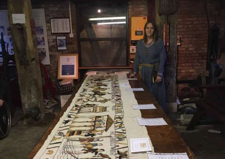 Mia Hansson with her replica of the Bayeux Tapestry. Photo supplied.