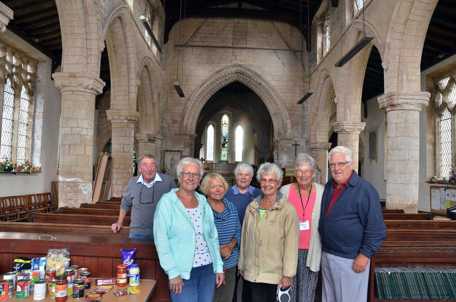 HELP CENTRE: Sutterton Foodbank volunteers at St Mary's Church are, from left,David Mossman, Mary Hubbert, foodbank coordinator Janet Mossman, Liz Beauchamp, Rosemary Goddard, June and Bob Greenslade.Photo (TIM WILSON):SG-210918-063TW