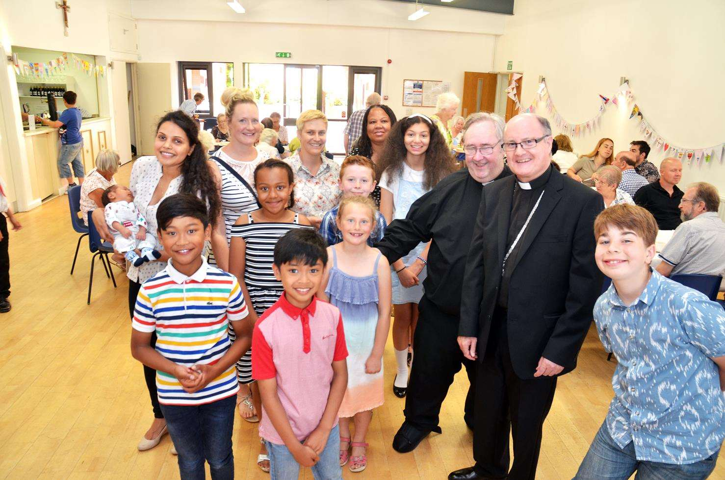 Father Jim Burke and Bishop of Nottingham meet some of congregation after service (010718130SG)