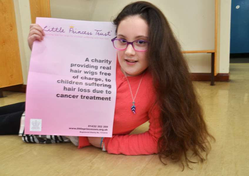 Lucy West is having her hair cut for the Little Princess Trust and has already smashed her original target of raising �300. Photo by Tim Wilson. SG090218-138TW.