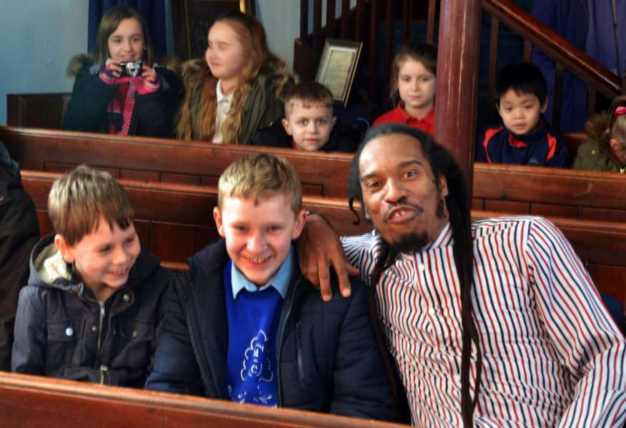 Benjamin Zephaniah and pupils before the poetry party