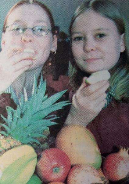Kayleigh Laurence and Alisha Sampson eat healthy apples back in 2001.