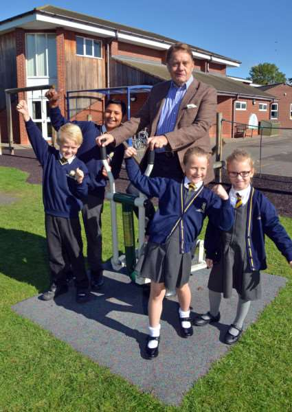 John Hayes MP and pupils try out the gym equipment at St Norbert's Catholic Primary School, Spalding. Photos (TIM WILSON): SG220917-125TW.