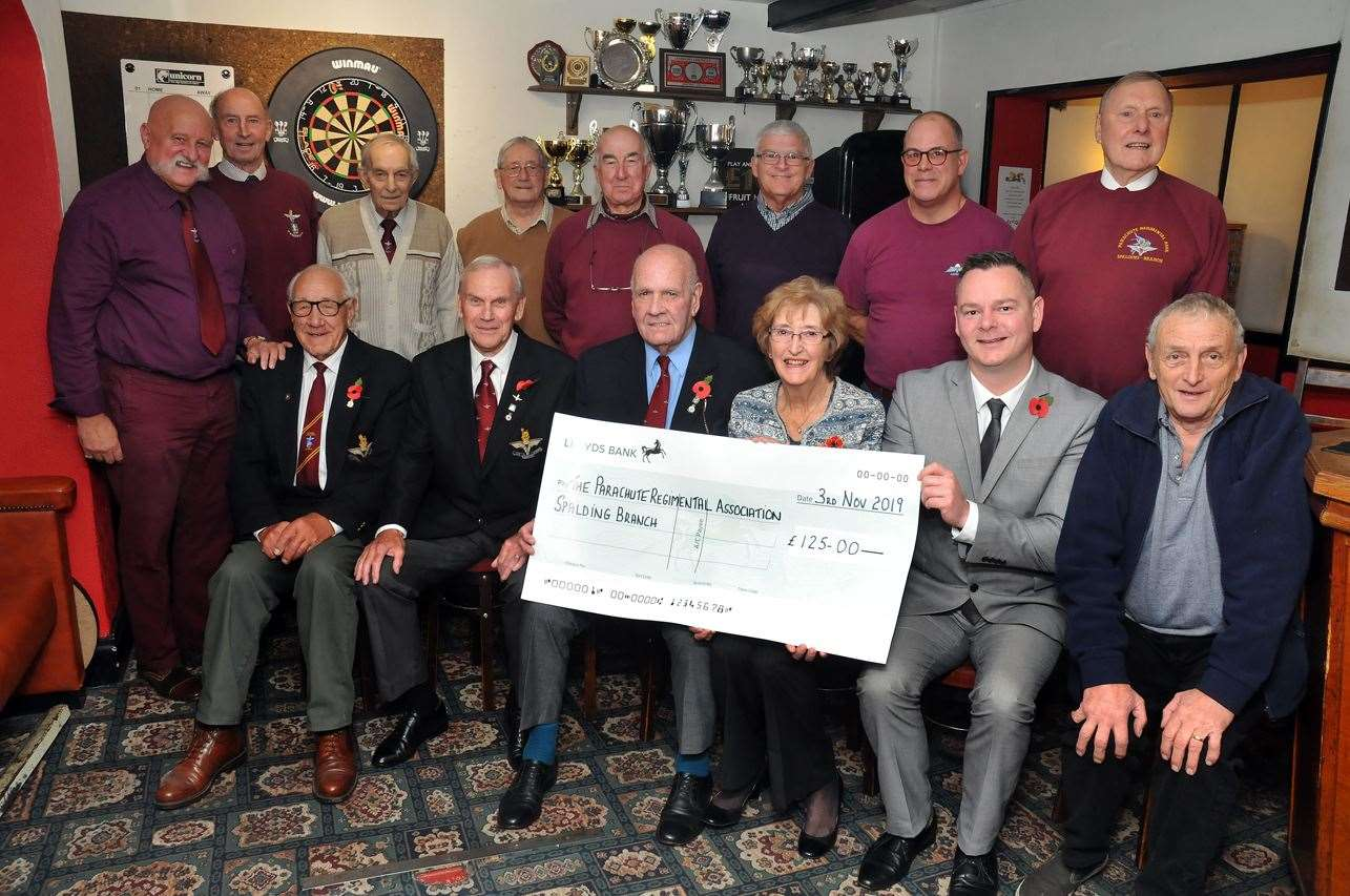 Angela Porter and her brother Maurice Dash (front, right) are pictured with members of Spalding branch of The Royal Parachute Regimental Association. Also on the front row, from left, are: Brian Elliott, Mike Franklin, chairman Richard Aylward and Free Press media sales consultant David Shea.