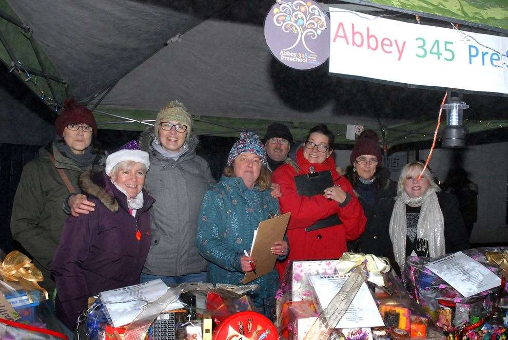 Abbey 345 Pre-School staff at their festive hamper stall during this year's Crowland Christmas Lights Switch-On.Photo by Tim Wilson