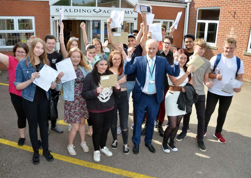 Executive head teacher Laurence Reilly and students celebrate Spalding Academy's record-breaking GCSE results. Photo by Tim Wilson. SG240817-142TW.