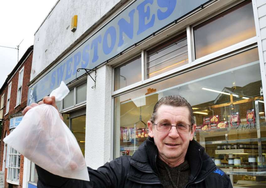 Swepstones Butchers Holbeach'Customer Karl Strowlger leaves with sausages