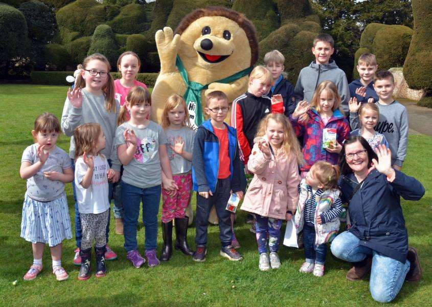 Linconlnshire Free Press and Spalding Guardian mascot Spike with children at the Macmillan Easter egg hunt. Photo (TIM WILSON): SG300318-131TW