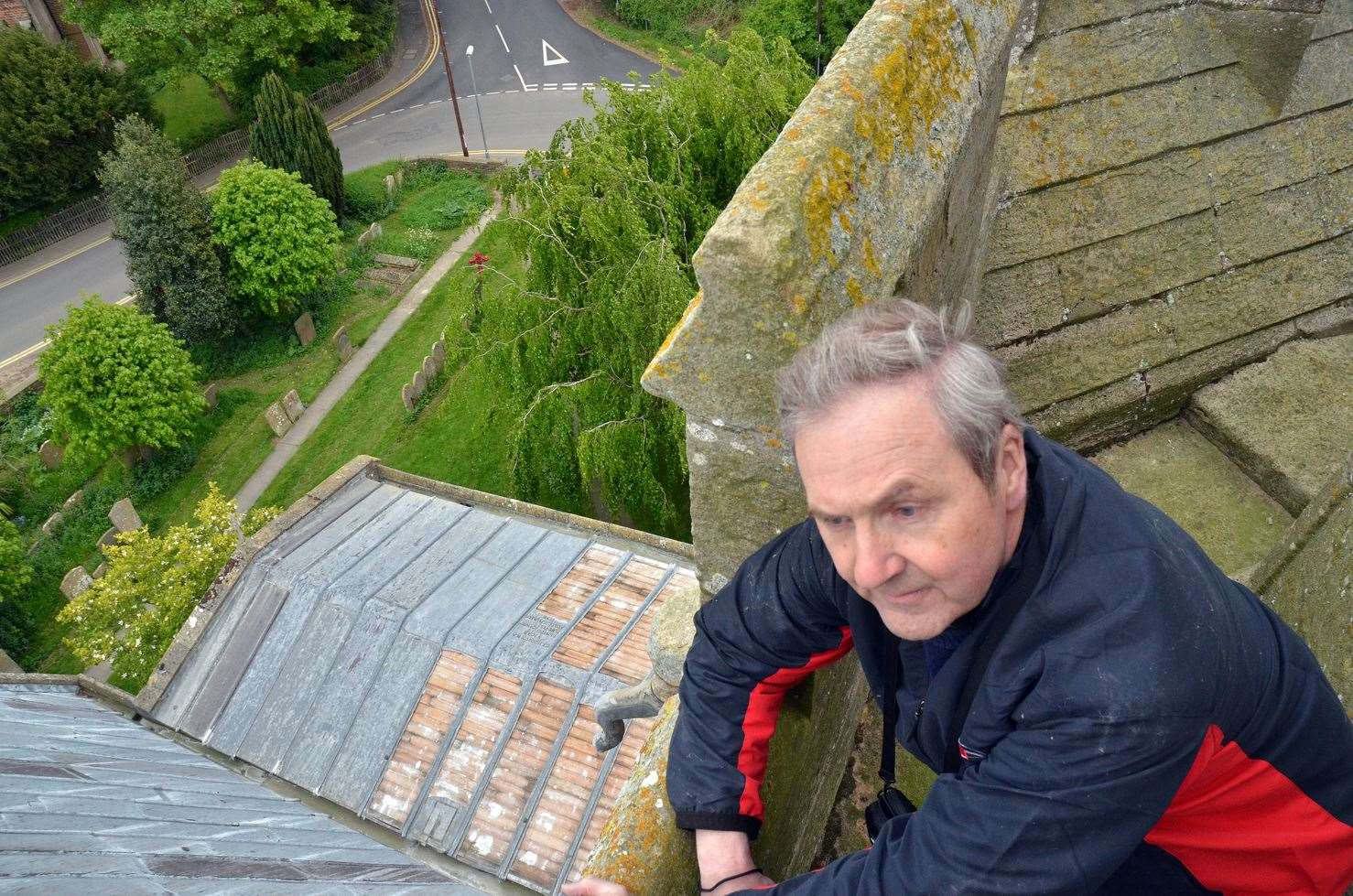 The Rev Ian Walters on the roof of St Peter and St Paul's Church, Gosberton, after lead was stripped off it twice within 48 hours.Photo by Tim Wilson.SG160519-052TW.
