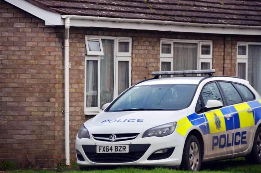 A police car outside the house this morning (Friday).