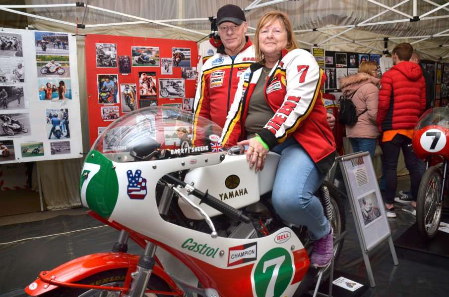 Neil and Viv Ward with their display of Barry Sheene memorabilia, including this 1970s racing bike. SG210118-101TW