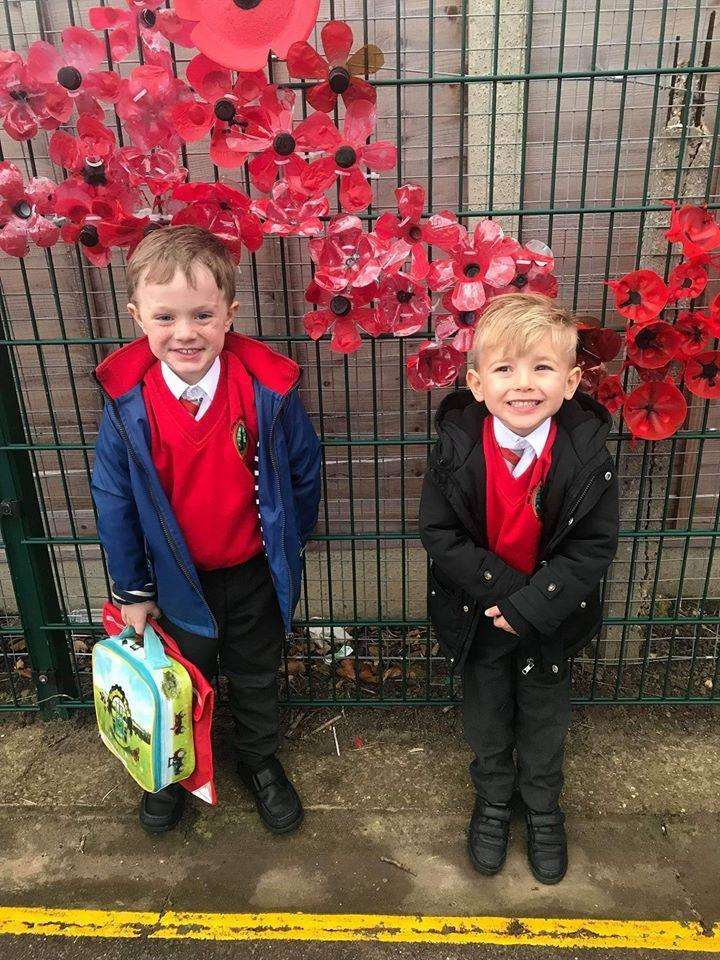Dorothy Keeble sent us this lovely picture of youngsters Freddie and Jack (both 4) by the poppy display outside of John Harrox Primary School in Moulton. (5386245)