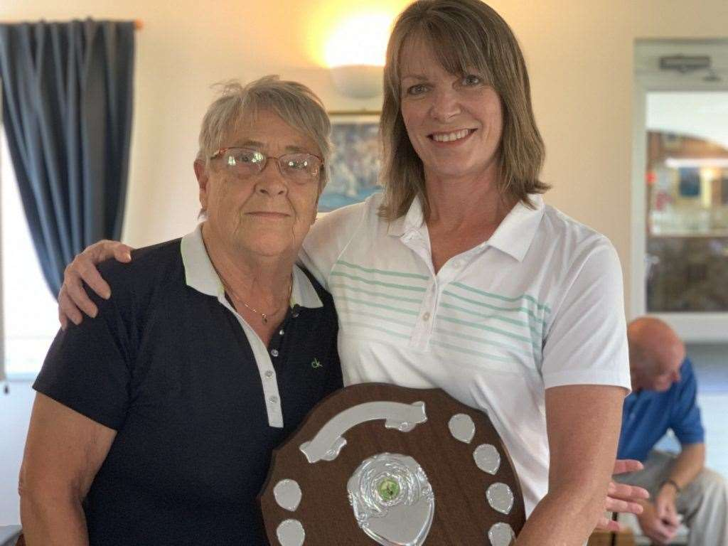 Gedney Hill Captains' Day overall winner Lynn Exley (right) receives the shield from Ann Chick.