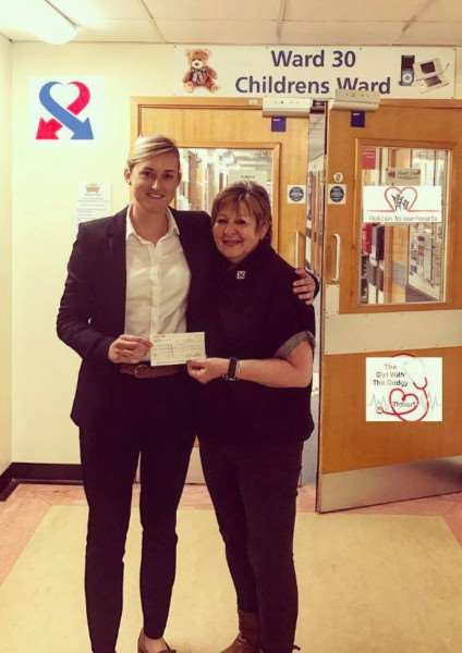 STRONG SUPPORTER: Spalding estate agency manager Tilly Milverton with Gill Tansey, of East Midlands heart charity Keep the Beat, who accepts a cheque for �2,025 at Glenfield Hospital. Photo supplied.