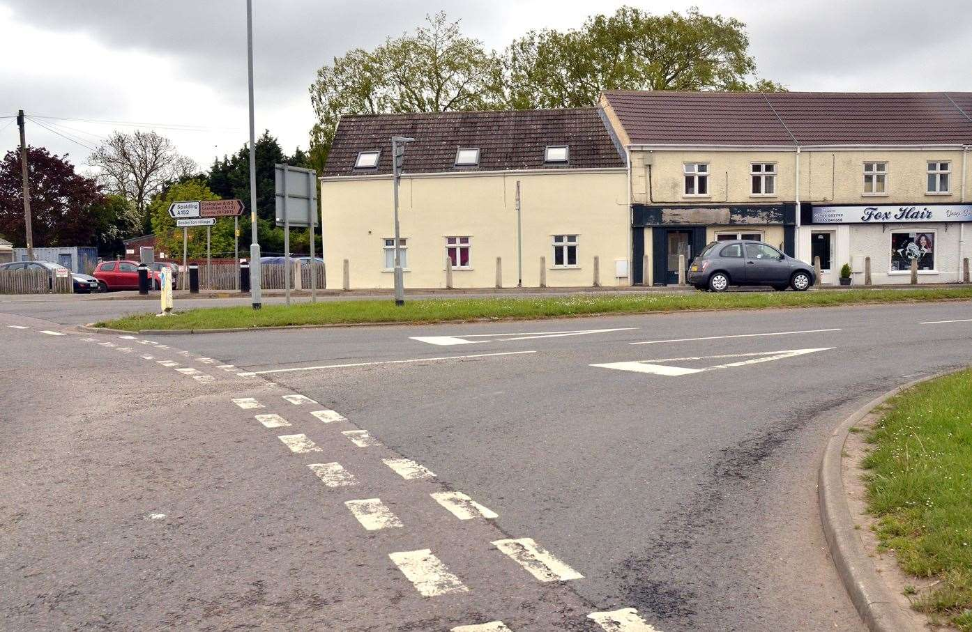 Painted Give Way lines are faded at a dangerous junction in Gosberton.