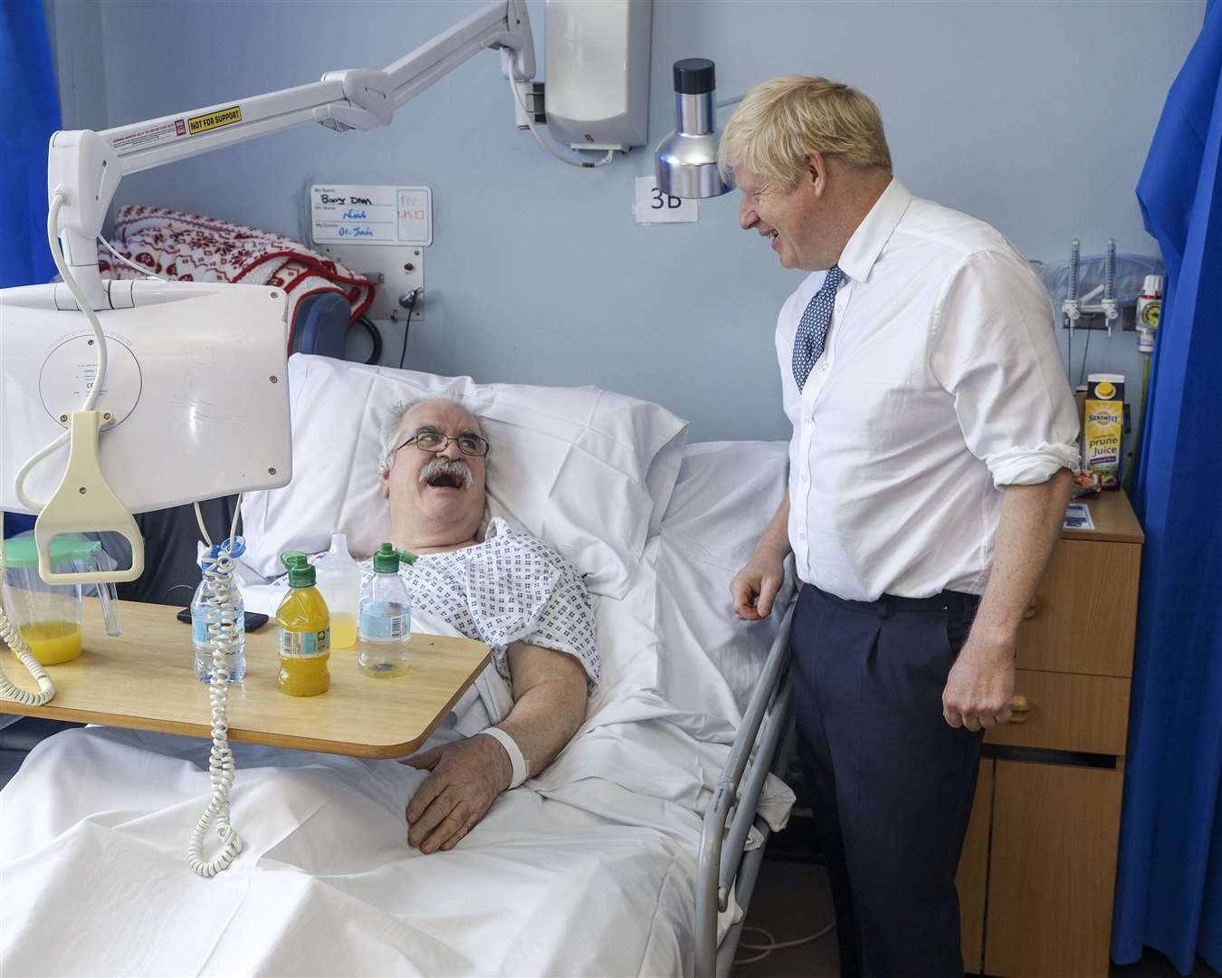 Bedside manner ... Prime Minister Boris Johnson chats to a Pilgrim patient during yesterday's visit
