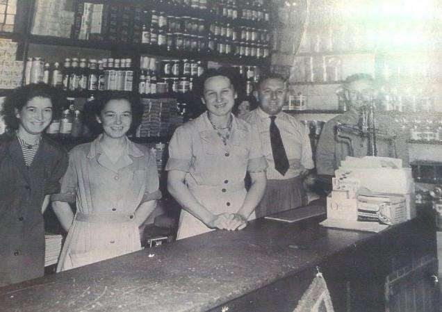 The grocery shop of George Johnson in Sutton St James. Left to right: Linda Spinks, Janet Heanes (Stanley Chapman's cousin), Freda Johnson (George's sister), George Johnson, Stanley Chapman.