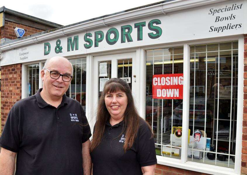 LAST SALES: 'David Broadhurst and Margaret Howes outside D & M Sports, Vine Street, Spalding, which is set to close this summer. Photo by Tim Wilson. SG230418-117TW.