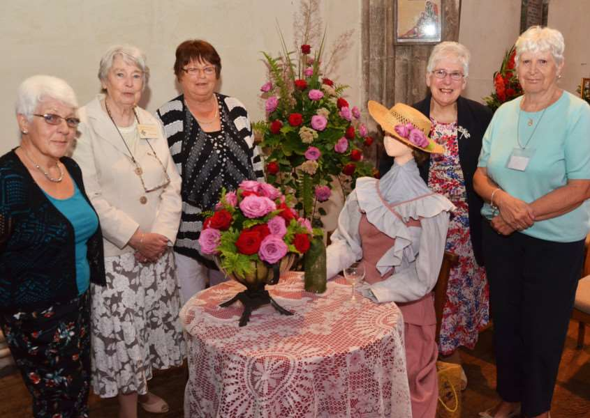 "Sheila Minton, Val Capes, Carole Cole, Libby Jackson and June Wortley at Crowland Abbey for its ""Art and Artists"" Flower Festival. Photo by Tim Wilson. SG260817-156TW."