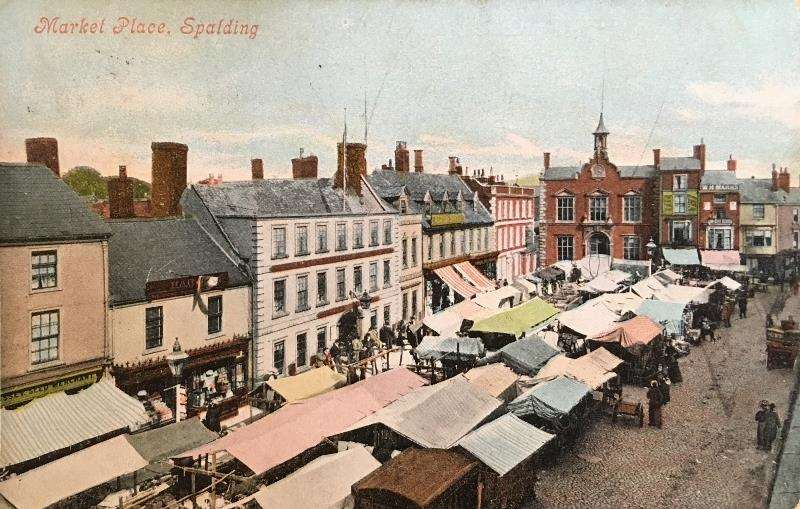 One of the postcards from the David Robinson collection features Spalding's market. (2059962)