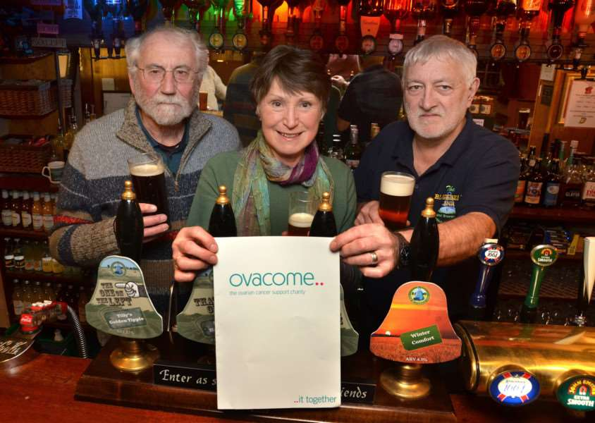 Lesley Sage pictured at last year's fundraiser with husband Pat (left) and landlord John Lusher. SG140217-114TW