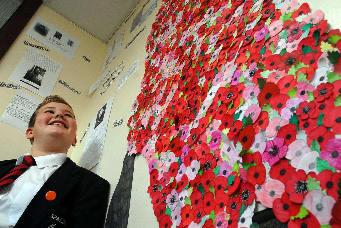 Harvey Farrar beside the Spalding Academy poppy display