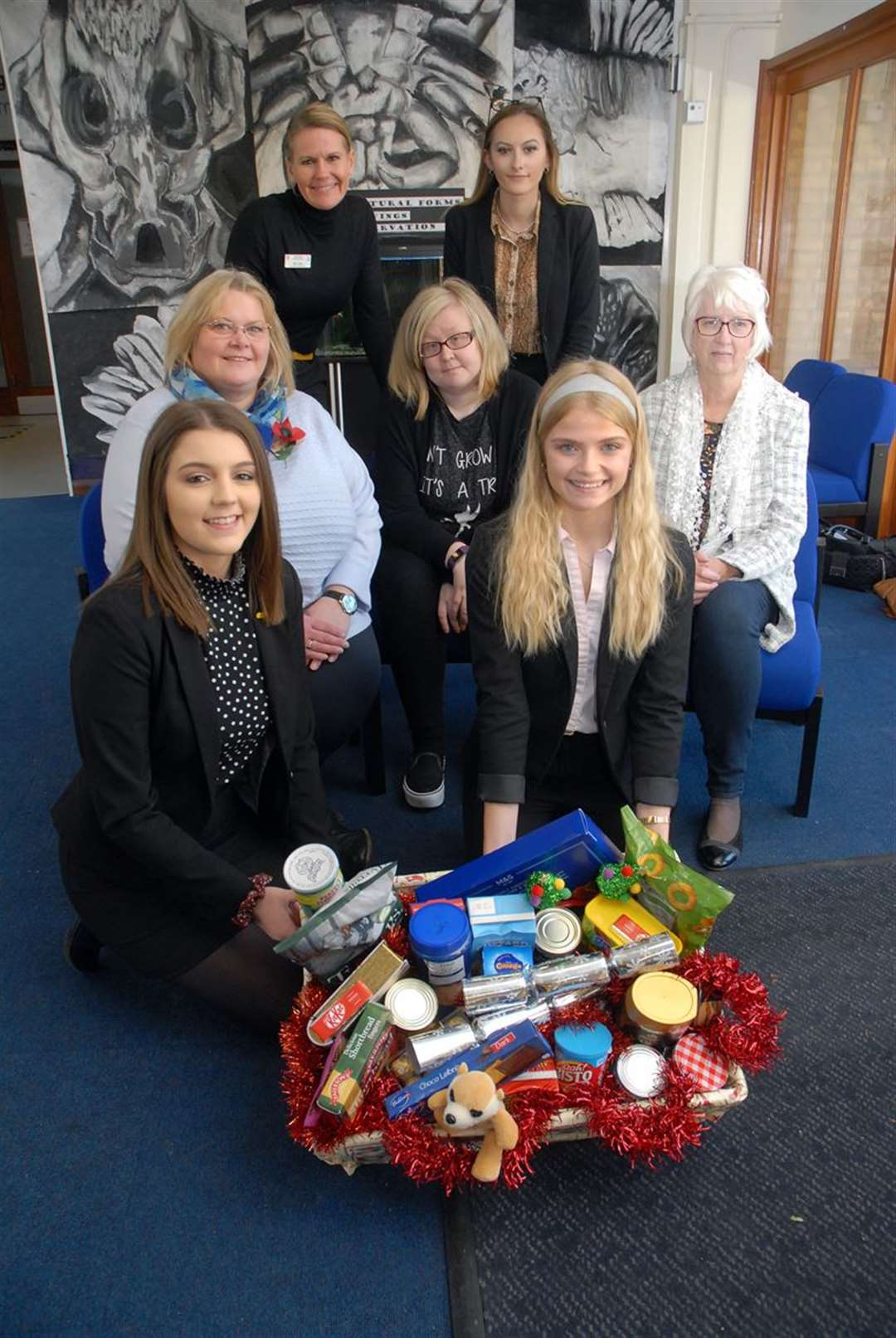 The launch of this year's Spalding Guardian Christmas Foodbank Appeal at Spalding High School, with (back) assistant head Lara Ray and student Hannah Lane, (middle) headmistress Michelle Anderson, foodbank volunteer Catherine Smith and foodbank coordinator, Irene Davies, (front) students Lucy Twelves and Grace Wood.Photo (TIM WILSON): SG-291019-002TW.