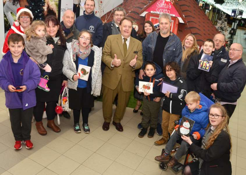 MP John Hayes with competition winners and sponsors at the Springfields Santa grotto. SG011217-223TW