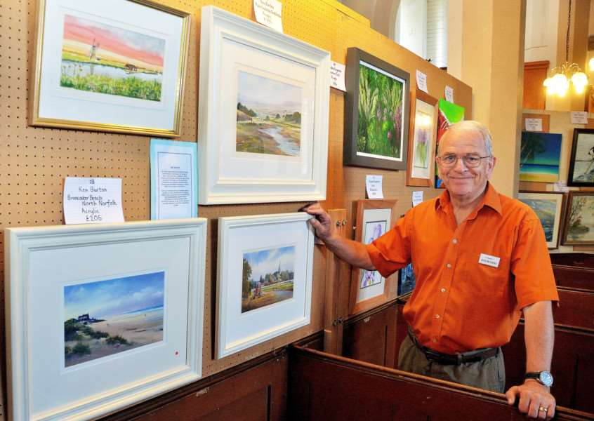 Artist Ken Burton with paintings at St Matthew's Church. SG260817-161TW