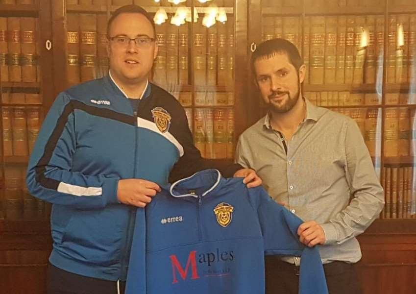 Lewis Thorogood (left) with Chris Ayre of Maples Solicitors who have sponsored the players' training tops this season