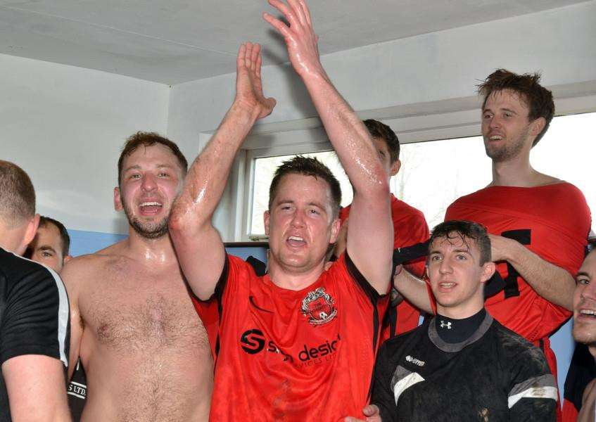 Club captain Nick Bishop leads the celebrations following promotion