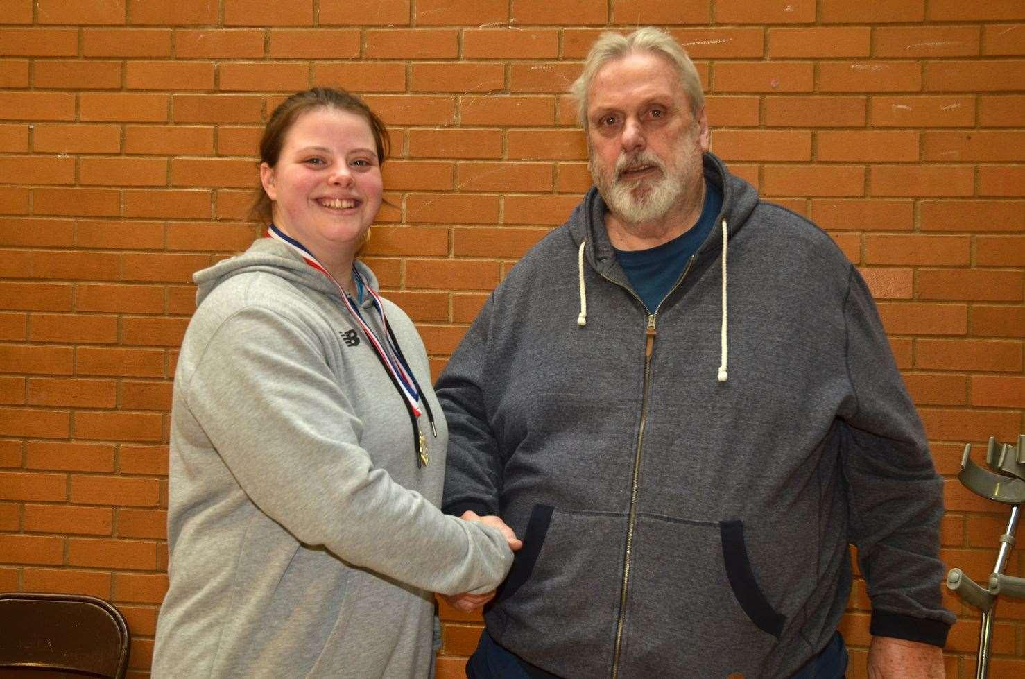 Elizabeth Moorhouse with Geoff Capes at a Lincs Throws Academy event in Bourne.Photo by Tim Wilson.SG-160220-137TW.