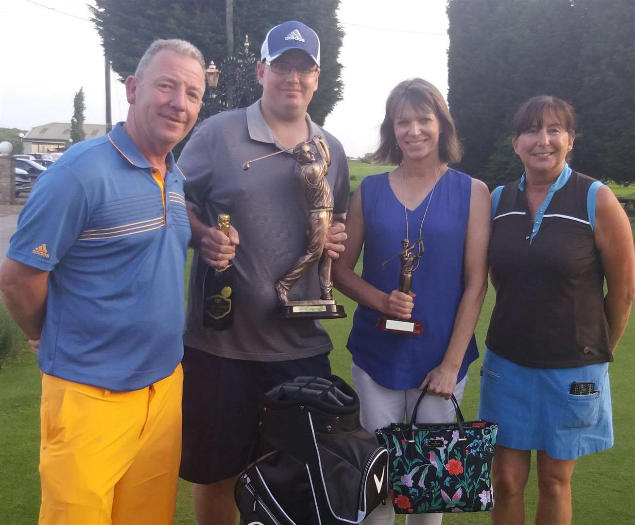 Nick and Kim Markillie (far left and right) with winners Lewis Field and Lynn Exley.