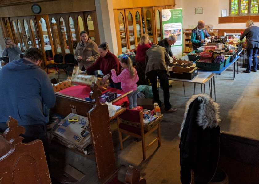 COMMUNITY EFFORT: Food hampers being packed at St Matthew's Church, Sutton Bridge, during the 2016 Christmas Foodbank Appeal. Photo supplied.