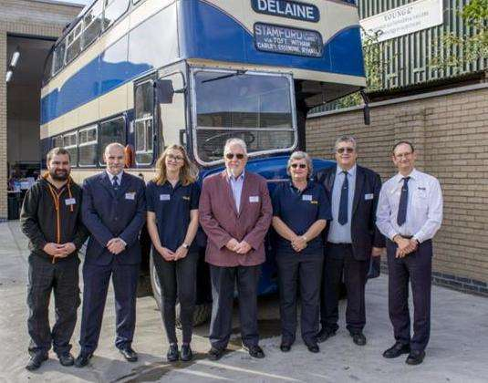 Anthony Delaine-Smith (second right), managing director of Delaine Buses, and staff. Photo by Lee Hellwing. (6782502)