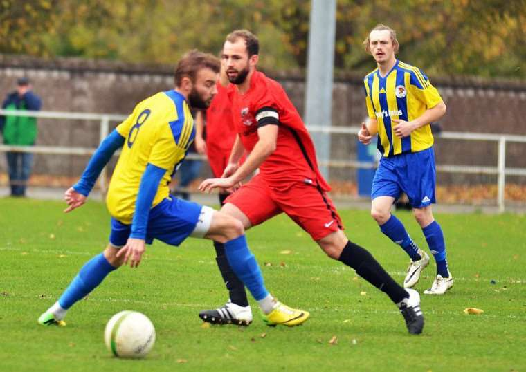Pinchbeck captain Luke Gardner in action against Irchester