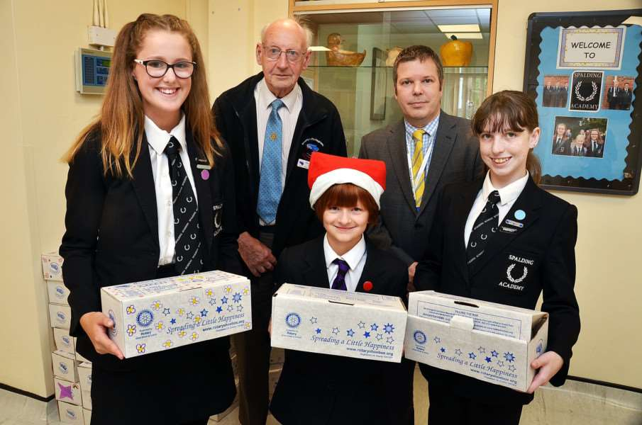 BOXES OF LOVE: Students Charlotte Knight, Sophie Male and Chrystal-Jane De Camps with Alan Geeson of the