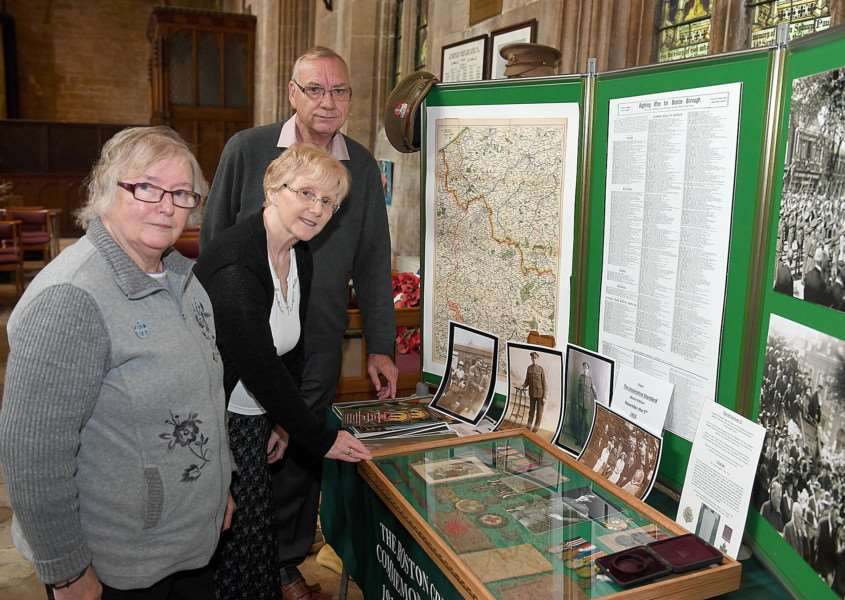 Carol Lidgett, Fay Houltby and Don Jenkins at St Peter and St Paul's Church, Kirton, looking at a display for Sgt Harold Jackson VC. Photo by David Dawson.