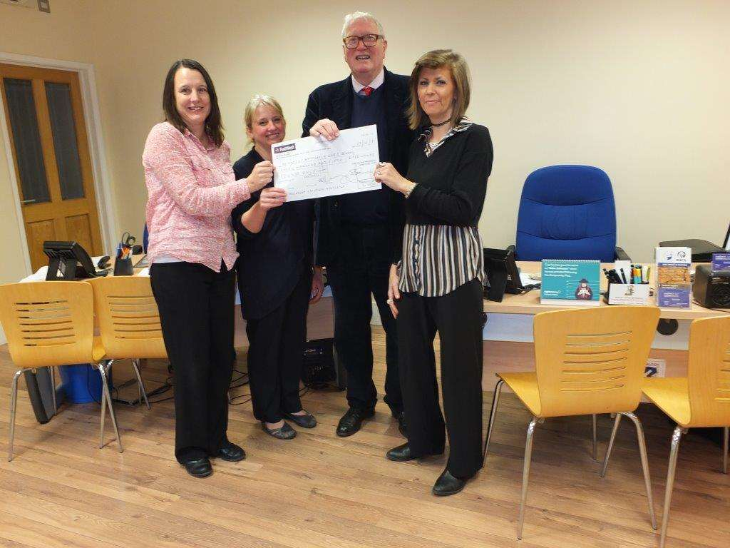 Mason David Wilson presents a cheque for £750 to Tracey Carter, Susan Parker and Debbie Machin, representing William Stukeley Primary School. (5735587)